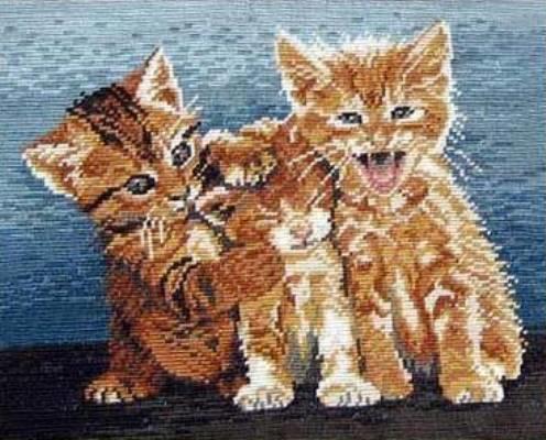 Очень красивая, а главное - несложная схема шитья крестом - это вышивка кошек