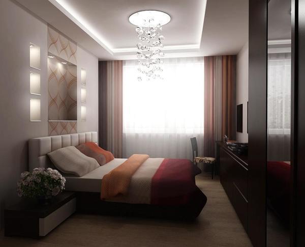 Визуально расширить пространство в спальной комнате можно при помощи зеркальных поверхностей