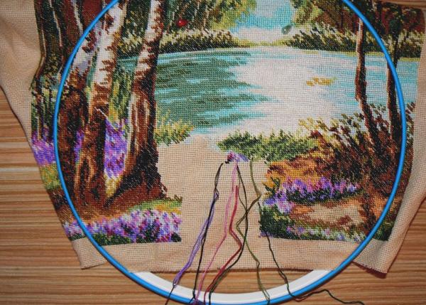 Если начать вышивать картину с середины, дальше легче следить за рисунком